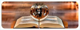 Книга с магическим шаром и силуэтом козы внутри